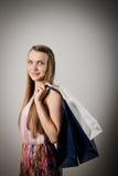 Dziewczyna i papierowe torby Fotografia Stock