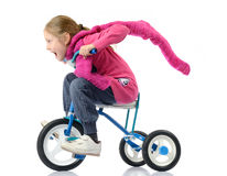 Dziewczyna jedzie bicykl na biały tle zdjęcie stock