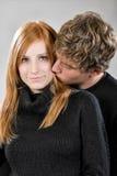 dziewczyna jego całowania mężczyzna potomstwa Obraz Stock