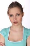 Dziewczyna jest ubranym błękitną koszulkę z makeup z bliska Biały tło Obraz Stock
