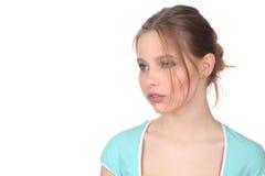 Dziewczyna jest ubranym błękitny odgórny patrzeć daleko od z bliska Biały tło Obrazy Stock