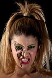 Dziewczyna Jest ubranym Błyskawicowego Makeup Robi Strasznemu Scowl Zdjęcia Stock