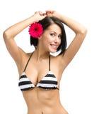 Dziewczyna jest ubranym bikini i kwiatu w włosy Zdjęcie Royalty Free