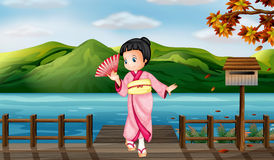 Dziewczyna jest ubranym chińską suknię z drewnianą skrzynką pocztowa royalty ilustracja