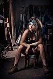 Dziewczyna jest ubranym hełm w kotłowym pokoju fotografia royalty free