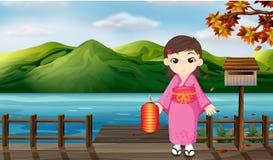 Dziewczyna jest ubranym kimonowego mienia lampion obok drewnianego mailbo royalty ilustracja