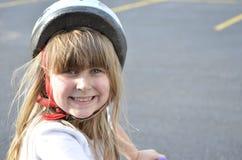 Dziewczyna jest ubranym hełm Zdjęcie Stock