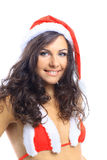 Dziewczyna jest ubranym Santa Claus odziewa zdjęcia stock