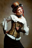 Dziewczyna jest ubranym steampunk kapelusz Obrazy Stock