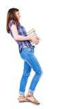 Dziewczyna komes z stertą książki Zdjęcie Royalty Free