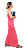 Dziewczyna komes z stertą książki Obraz Royalty Free