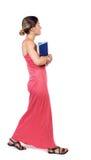 Dziewczyna komes z stertą książki Fotografia Stock