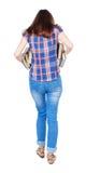 Dziewczyna komes z stertą książki Obrazy Royalty Free