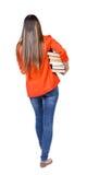 Dziewczyna komes z stertą książki Fotografia Royalty Free