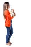 Dziewczyna komes z stertą książki Zdjęcie Stock
