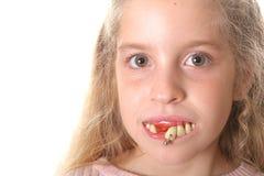 dziewczyna kopii zostawił trochę ładnych kosmicznych brzydkie zęby. Obraz Royalty Free