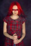 dziewczyna kordzik włosiany czerwony Zdjęcie Royalty Free
