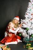 dziewczyna mały bawić się Santa Zdjęcia Royalty Free