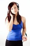 dziewczyna hełmofony Obraz Royalty Free