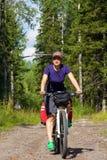 Dziewczyna na bicyklu w lesie Obrazy Royalty Free