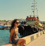 Dziewczyna na doku. Obraz Stock