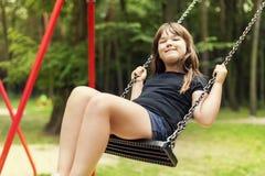 Dziewczyna na huśtawce Obrazy Royalty Free