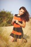 Dziewczyna na piasku Obrazy Royalty Free