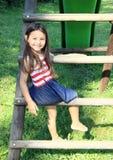 Dziewczyna na schodkach ono ślizgać się Obrazy Royalty Free