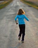 dziewczyna oddalony bieg Zdjęcia Royalty Free