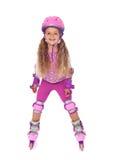dziewczyna odizolowywający roześmiany mały rolkowy łyżwiarstwo Fotografia Royalty Free