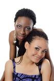Dziewczyna oliwkowa i czarna dziewczyna Obrazy Royalty Free
