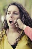 Dziewczyna ono uderza pięścią w twarzy Obraz Stock