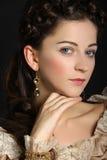 Dziewczyna patrzeje kamerę w barok sukni Obrazy Royalty Free