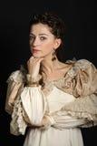 Dziewczyna patrzeje kamerę w barok sukni Zdjęcie Royalty Free