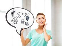 Dziewczyna pokazuje teksta bąbel z szybkie żarcie ikonami Obraz Royalty Free