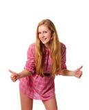 dziewczyna pokazywać dwa uśmiechniętego potomstwa uśmiechniętym kciukom Obrazy Royalty Free