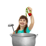 Dziewczyna próbuje gotować Obraz Royalty Free