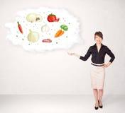 Dziewczyna przedstawia odżywczą chmurę z warzywami Zdjęcia Royalty Free