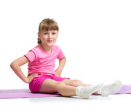 Dziewczyna robi gimnastycznym ćwiczeniom Fotografia Stock
