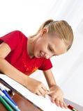 Dziewczyna robi jej pracie domowej Zdjęcia Royalty Free