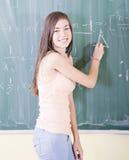 Dziewczyna robi maths Zdjęcia Royalty Free
