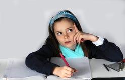 Dziewczyna robi maths pracie domowej Obrazy Royalty Free