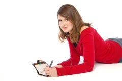 dziewczyna robi notatki zdjęcia stock