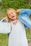 Dziewczyna robi twarzom imitować czarownicy Obraz Royalty Free
