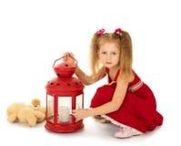 Dziewczyna rozognia lampę Obraz Royalty Free