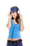 dziewczyna słucha muzycznych potomstwa fotografia stock