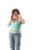 Dziewczyna słucha muzyka Zdjęcia Stock