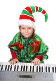 Dziewczyna - Santa elf bawić się syntetyka. Obrazy Stock