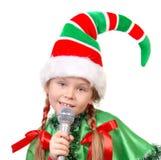 Dziewczyna - Santa elf z mikrofonem Obrazy Stock