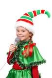Dziewczyna - Santa elf z mikrofonem. Obraz Stock